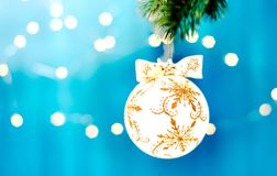 Christmas decoration on a branch with copy space. Merry christmas. Blue and silver xmas decoration copy space. Merry christmas Royalty Free Stock Photos