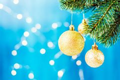 Christmas decoration on a branch with copy space. Merry christmas. Blue and silver xmas decoration copy space. Merry christmas Royalty Free Stock Photo