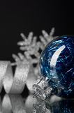 Blue and silver xmas ornaments on black background Royalty Free Stock Images