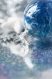 Blue and silver xmas ornaments on bright holiday b Stock Photos