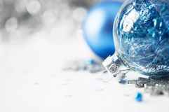 Blue and silver xmas ornaments on bright holiday b Royalty Free Stock Photography