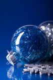 Blue and silver xmas ornaments on dark blue background Stock Photos