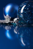 Blue and silver xmas ornaments on dark blue background Royalty Free Stock Image