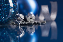 Blue and silver xmas ornaments on dark blue background Royalty Free Stock Photo