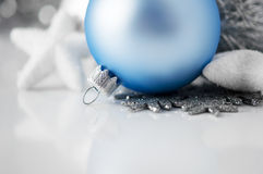 Blue and silver xmas ornaments on white background Royalty Free Stock Image