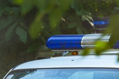 Blue siren flasher on the police car. Flash light and siren on the emergency car. Police signal. Blue siren flasher on the police car. Flash light and siren on stock photography