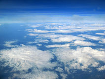 Blue skies. Blue sky above the clouds while flying under the sun Stock Images