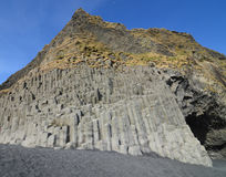 Blue Skies Above the Basalt Columns on Black Sand Beach Stock Photography