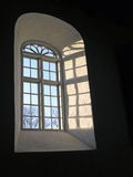 Blue Skies Through Church Window. Taken from inside the stone church at brodebro, southern denmark. light and dark shadows, with windows framing a blue sky are Stock Images