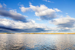 Blue Skies. And Clouds Over Evening Lake in Finland Stock Photography