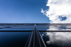 Blue skies and clouds reflecting in modern building Stock Images