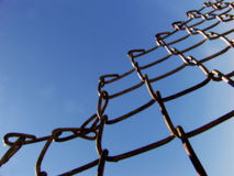 Blue Skies Fenceline. Chaine link fence adjacent blue sky Royalty Free Stock Photos