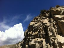 Blue Skies. High contrast clouds and desert rock point royalty free stock photo