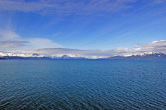 Blue skies and ocean and glacial mountains Royalty Free Stock Photo