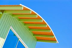 Blue skies and orange and blue roof Stock Photo