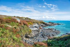 Blue Skies Over Prussia Cove in Cornwall Stock Photos