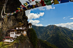 Blue skies and prayer flags over Taktsang 'Tigers Nest' Monastery, Paro, Bhutan Royalty Free Stock Photos