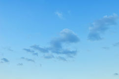 Blue skies with some clouds in the sky is bright. Royalty Free Stock Image