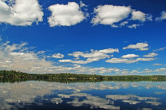Blue skies and white clouds in the Quetico Royalty Free Stock Image