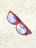 Blue skies and white clouds reflection on sunglasses Stock Photo
