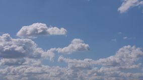 Blue Skies with White Fluffy Clouds Moving Left to Right Slowly