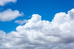 Blue skies and white fluffy clouds at Semaphore beach South Australia on 7th November 2018 royalty free stock image
