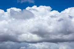 Blue skies and white fluffy clouds at Semaphore beach South Australia on 7th November 2018 stock image