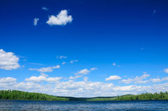 Blue skies in the wilderness. Blue skies over Basswood Lake in the Quetico Wilderness in Canada Stock Image