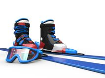 Blue skiis with blue rimmed ski goggles Stock Photos
