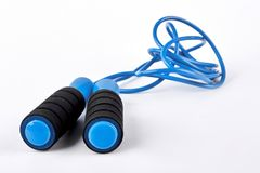 Blue skipping rope on white background. Royalty Free Stock Photo