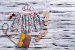 Blue skirt with floral print. Royalty Free Stock Photography
