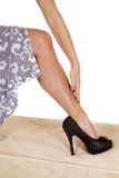 Blue skirt hand brush leg black heels Stock Photos