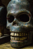 Blue skull in the low light Stock Images