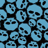 Blue skulls over black background seamless pattern, geometric co Royalty Free Stock Photo
