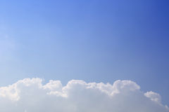 Blue sky. Under the blue sky white clouds royalty free stock photo