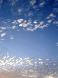 Blue sky. With bundle of white clouds in the evening Royalty Free Stock Photos