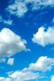Blue Sky. A deep blue sky with fluffy white clouds Stock Images
