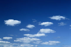 Blue sky. With some white puffy clouds Stock Image