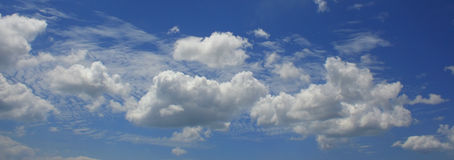 Blue Sky. White clouds in a bright blue sky Royalty Free Stock Photo