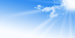 Blue sky. During a sunny day with sunlight. sun somes clouds, free space for text Royalty Free Stock Images