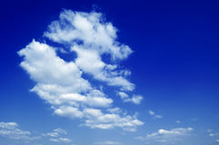 The blue sky. The white clouds on background blue sky Royalty Free Stock Photo