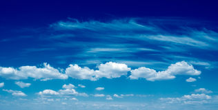 The blue sky. The beautiful white clouds on background blue sky Royalty Free Stock Photo
