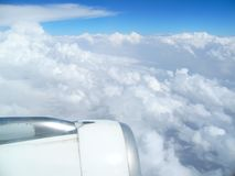 Blue sky. Cloudscape and engine view from an airplane royalty free stock photography