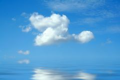 Blue sky. With white clouds and water Royalty Free Stock Image