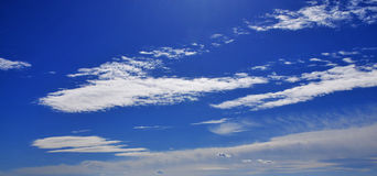 Blue sky. White clouds on the blue sky stock images