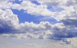 Blue sky. White clouds on the blue sky stock photography