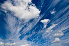 Blue sky. Deep blue sky with clouds - useful for backgrounds Stock Photo