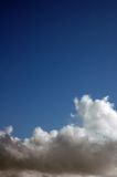 Blue sky. Clouds against blue sky that has alot of negative space royalty free stock image