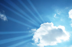 Blue sky. And sun beams through the cloud Royalty Free Stock Photo