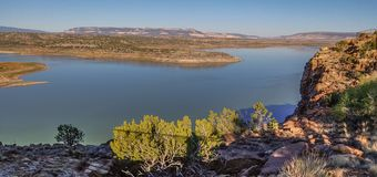 Abiquiu Lake and Cerro Pedernal in New Mexico. Blue sky above Abiquiu Lake and the mountains in northern New Mexico royalty free stock image